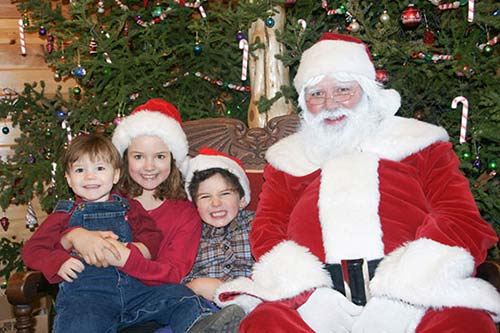 Kids sitting on santa's lap
