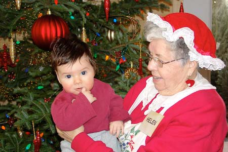 Mrs Claus holding baby