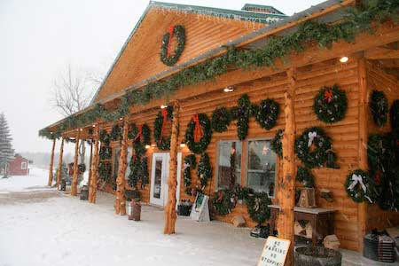 Snow falling in front of Christmas shop