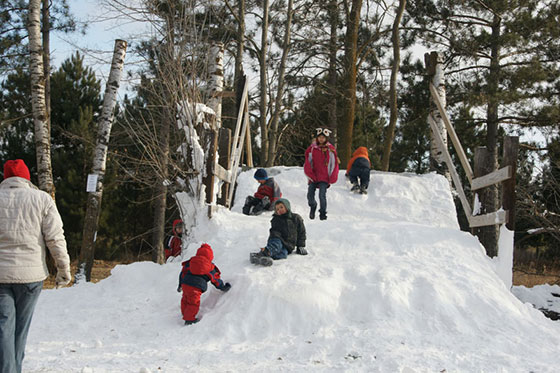 Kids Playing on Snow Hill